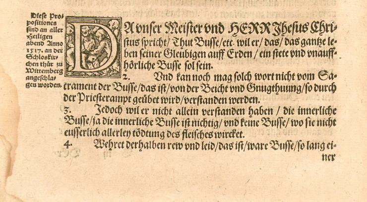 Martin Luther skrev 95 teser mod afladen og tømrede dem fast på døren af slotskirken i Wittenberg.